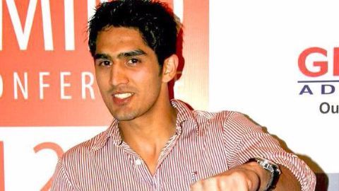 Vijender makes impressive pro-debut with win over Whiting