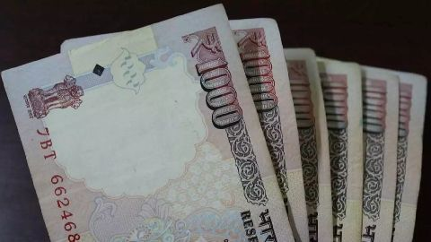 Rupee may touch 70/$ mark