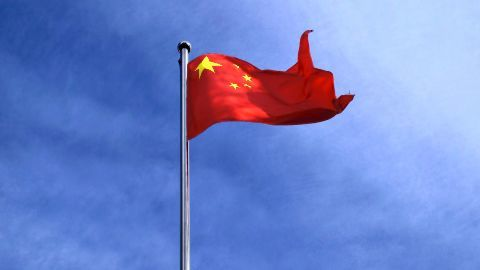 China lands military jet on disputed island