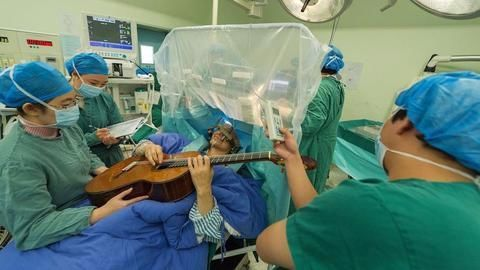 Bengaluru man plays guitar as surgeons 'burn' his brain